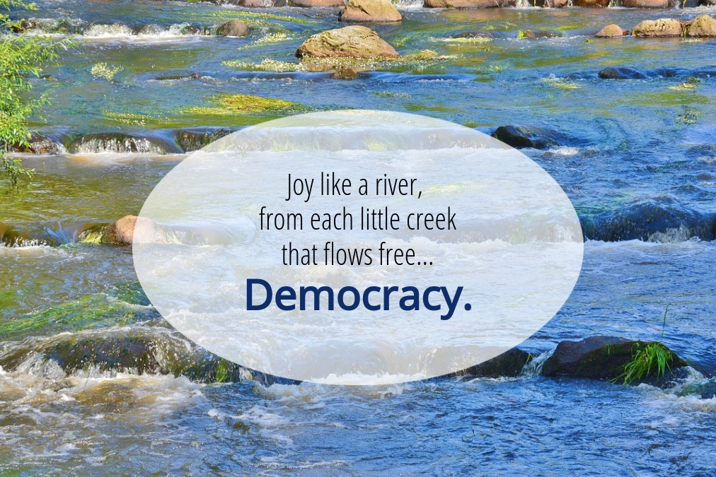 """Background: blue and white water tumbling over rocks. Text: """"Joy like a river, from each little creek that flows free... Democracy."""""""