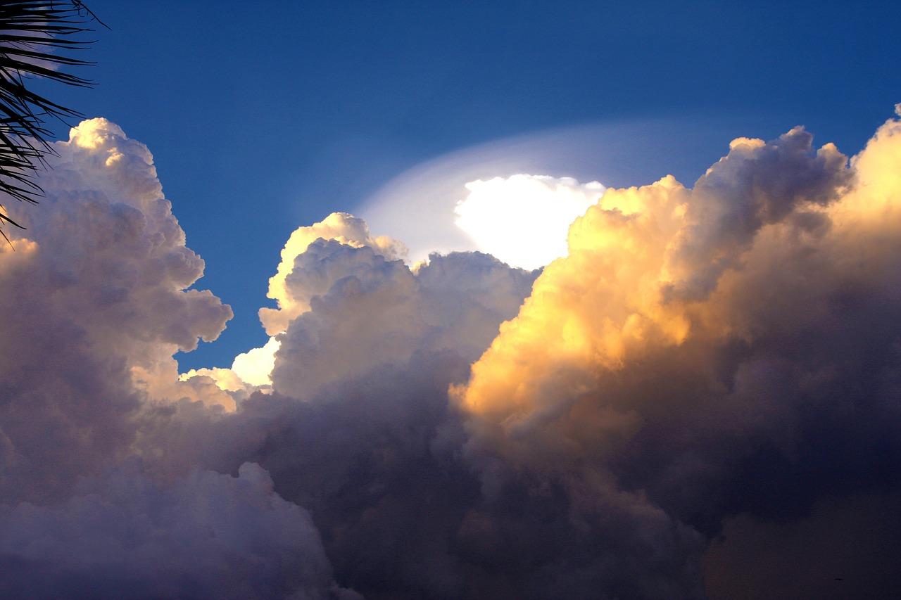 Sun getting hidden behind storm clouds