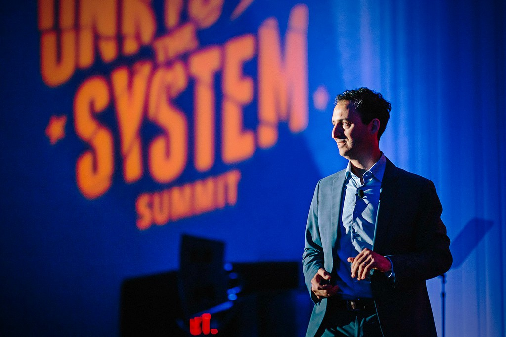 Josh Silver speaking at the Unrig the System Summit