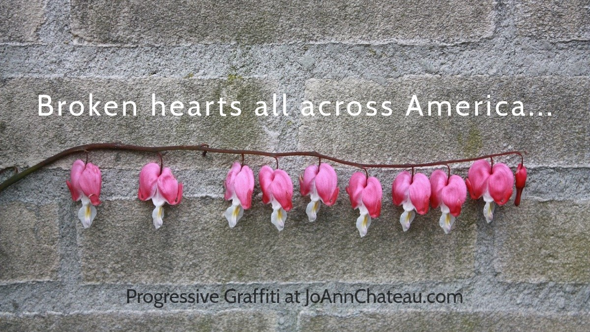 Broken hearted flowers against a gray stone wall