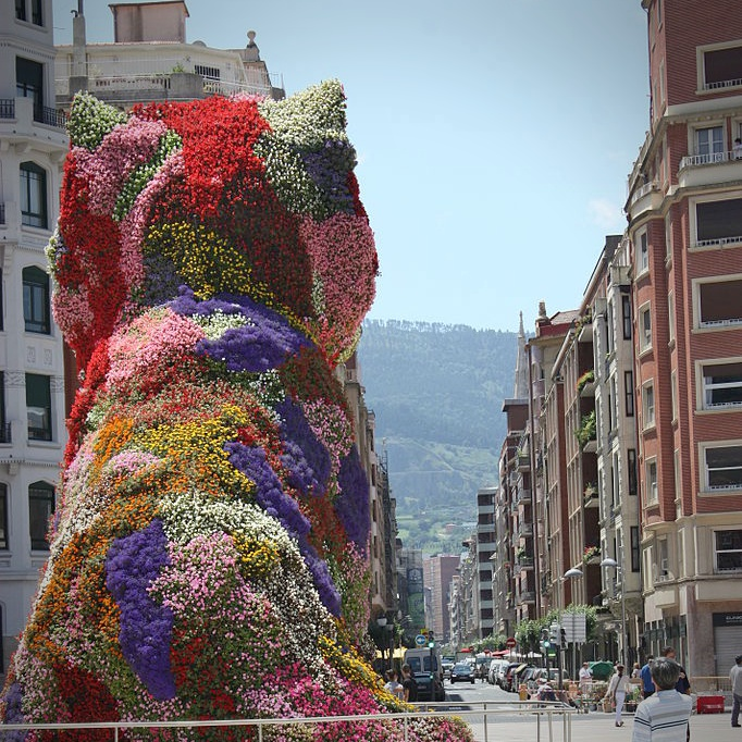 """""""Puppy"""" gazes at the distant hills of Bilbao, Basque Country, Spain."""