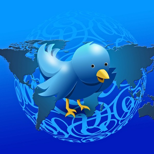 A Twitter Bird flying high above the Earth.