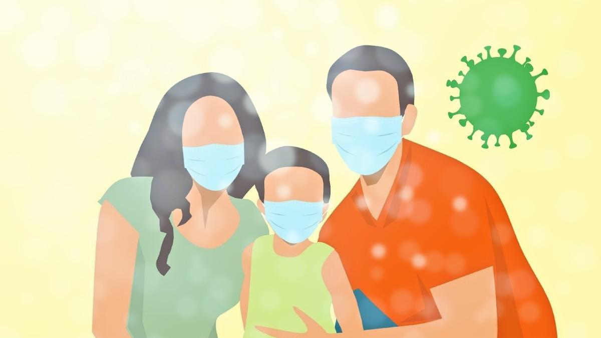 A family wearing coronavirus face masks