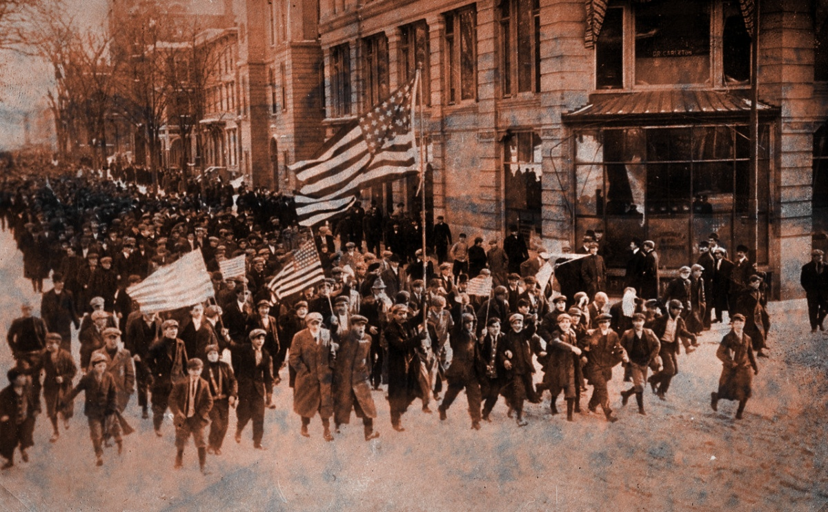 Strikers march down street in Lawrence, Massachusetts during the 1912 strike.